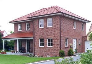 Кирпичная кладка фасада дома